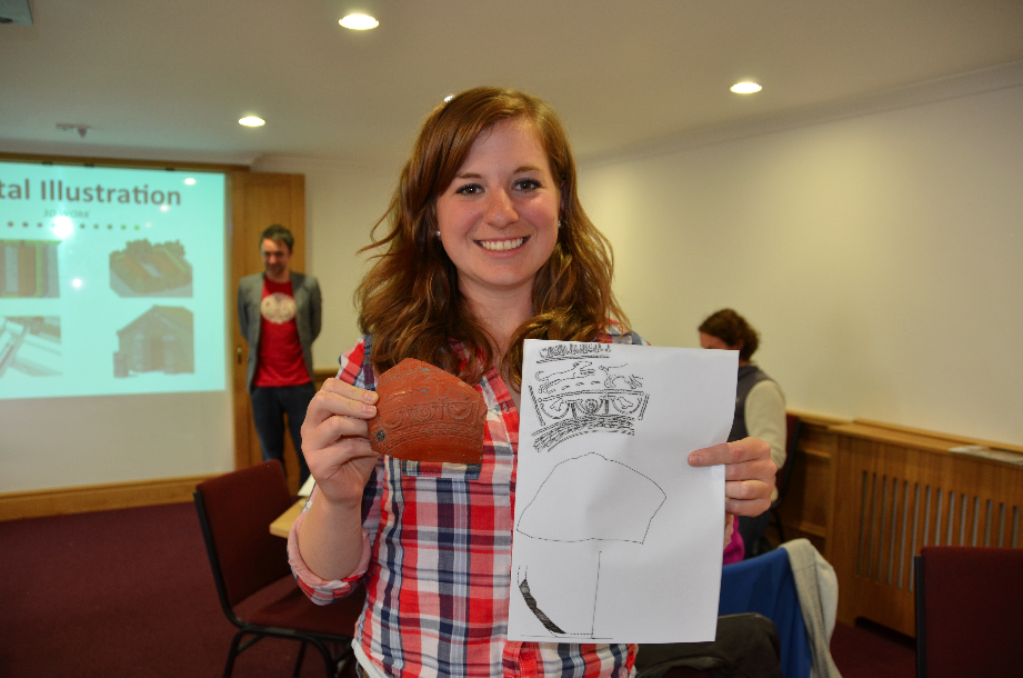 A student from the illustration workshop drawing detailed Samian Ware